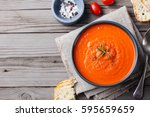 tomato soup in a black bowl on... | Shutterstock . vector #595659659