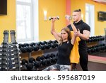woman with her personal fitness ... | Shutterstock . vector #595687019