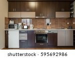 dark brown modern kitchen... | Shutterstock . vector #595692986