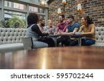 group of friends are... | Shutterstock . vector #595702244