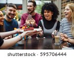 group of friends are in a bar... | Shutterstock . vector #595706444