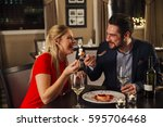 couple are sharing a dessert in ... | Shutterstock . vector #595706468