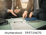 business people negotiating a... | Shutterstock . vector #595714670