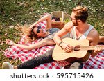 man playing guitar to his girl... | Shutterstock . vector #595715426