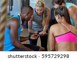 friends in gym sharing new... | Shutterstock . vector #595729298