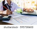 business woman analyzing... | Shutterstock . vector #595730603