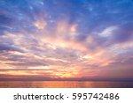 fiery backdrop over water    Shutterstock . vector #595742486