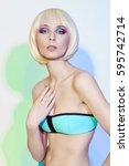 fashion art portrait of a woman ...   Shutterstock . vector #595742714