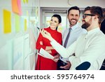 group of happy executives ... | Shutterstock . vector #595764974
