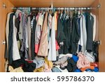 pile of messy clothes in closet.... | Shutterstock . vector #595786370