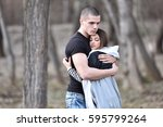 young couple strongly hugging... | Shutterstock . vector #595799264