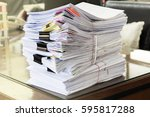pile of unfinished documents on ... | Shutterstock . vector #595817288