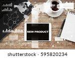tablet on desktop with new... | Shutterstock . vector #595820234