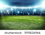 football pitch and blue lights  | Shutterstock . vector #595826966
