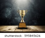 champion golden trophy placed... | Shutterstock . vector #595845626