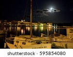 fishing boats at the port of... | Shutterstock . vector #595854080