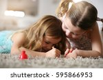 two little girls painted their... | Shutterstock . vector #595866953