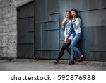 portrait of two young and... | Shutterstock . vector #595876988