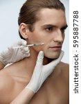 male beauty injection. portrait ...   Shutterstock . vector #595887788