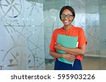 portrait of a smiling young... | Shutterstock . vector #595903226
