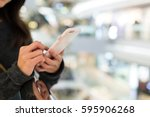 woman use of mobile phone   Shutterstock . vector #595906268