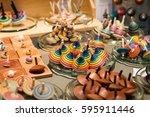 market stall full of wooden... | Shutterstock . vector #595911446