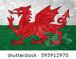 Small photo of Wales - Welsh Flag on Old Grunge Texture Background