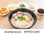 rice porridge with pork and egg ... | Shutterstock . vector #595921340