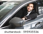 happy smiling driver in the car ... | Shutterstock . vector #595935536