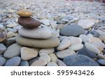 folded pyramid zen pebble... | Shutterstock . vector #595943426