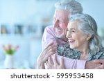 happy elderly couple embracing | Shutterstock . vector #595953458
