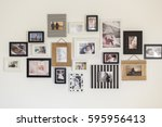 White Wall With Photos Of The...