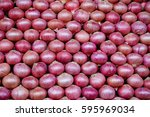 stacks of red onions