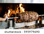 Small photo of Turkish Cag Kebab Doner in wood fired oven.