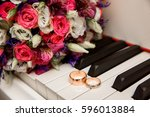 wedding bouquet and ring lying... | Shutterstock . vector #596013884