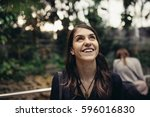 Small photo of Excited woman looking surprised and amazed,smiling,looking up.Young tourist backpacker woman excited,overwhelmed,looking at something amazing on her trip.Traveling on beautiful places.Admiring