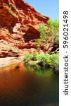 Small photo of Garden of Eden waterhole in an outback gorge in the middle of the desert