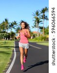 Small photo of Healthy Asian woman runner jogging on urban road. Fitness girl athlete working out living an active lifestyle training cardio in the morning running in pink activewear. Full body.