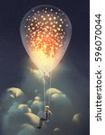 man and big balloon with... | Shutterstock . vector #596070044