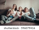 the family is sitting on the... | Shutterstock . vector #596079416