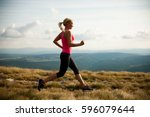 runner   woman runs cross... | Shutterstock . vector #596079644