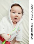 cute baby in bathrobe | Shutterstock . vector #596100320