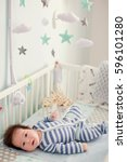 baby boy in his crib | Shutterstock . vector #596101280