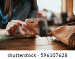 hand of woman using smartphone...   Shutterstock . vector #596107628