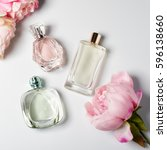 perfume bottles with flowers on ... | Shutterstock . vector #596138660