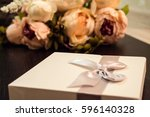 White Gift Box With Flowers....