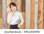 asian woman working  at a cafe | Shutterstock . vector #596143490