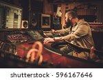 sound engineer and guitarist... | Shutterstock . vector #596167646
