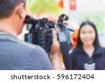 professional cameraman  ...   Shutterstock . vector #596172404