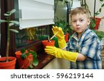 the boy takes care of flowers...   Shutterstock . vector #596219144
